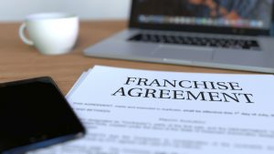 Copy of franchise agreement on the desk