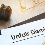 Documents unfair dismissal and gavel in a court